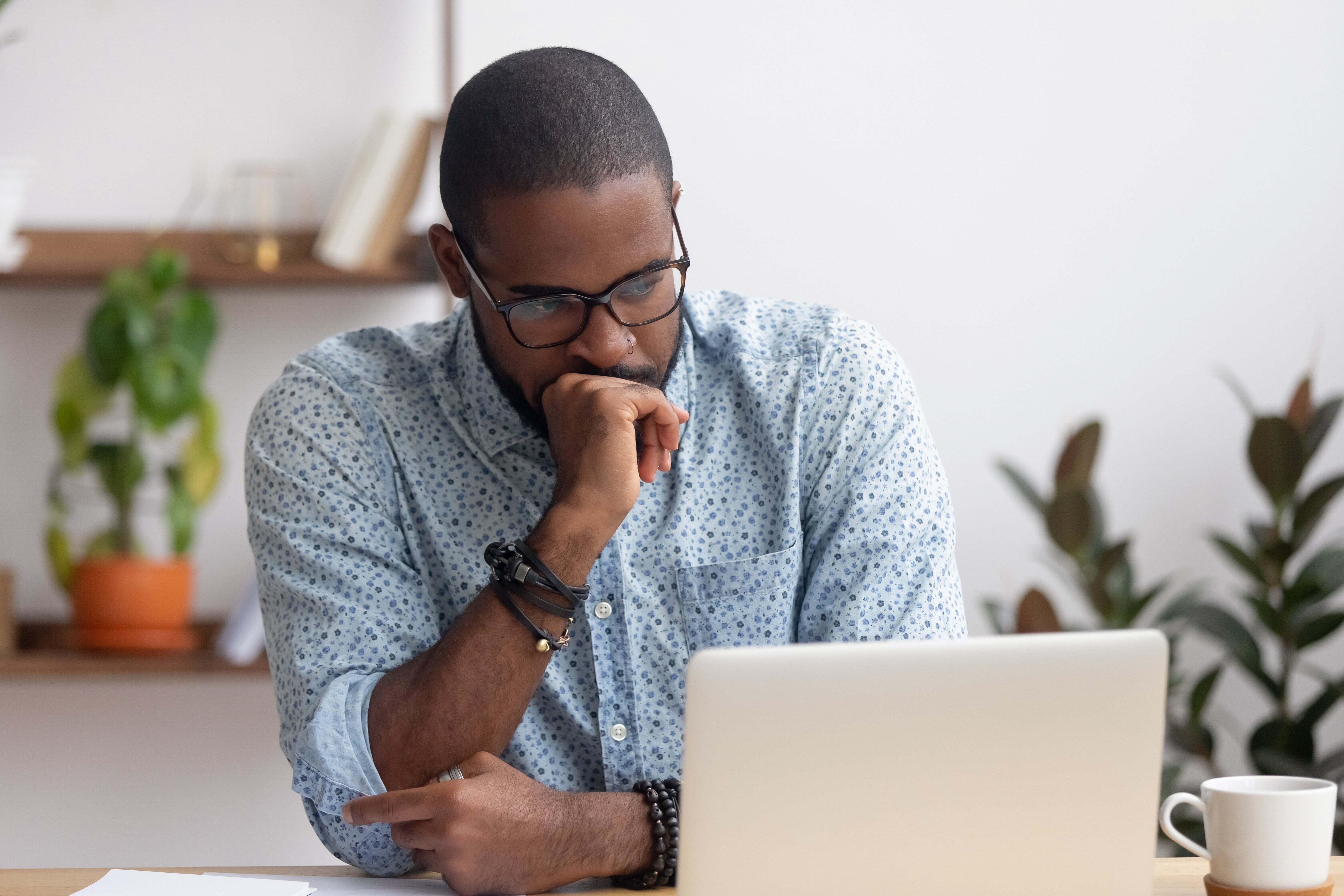 A man staring at his laptop