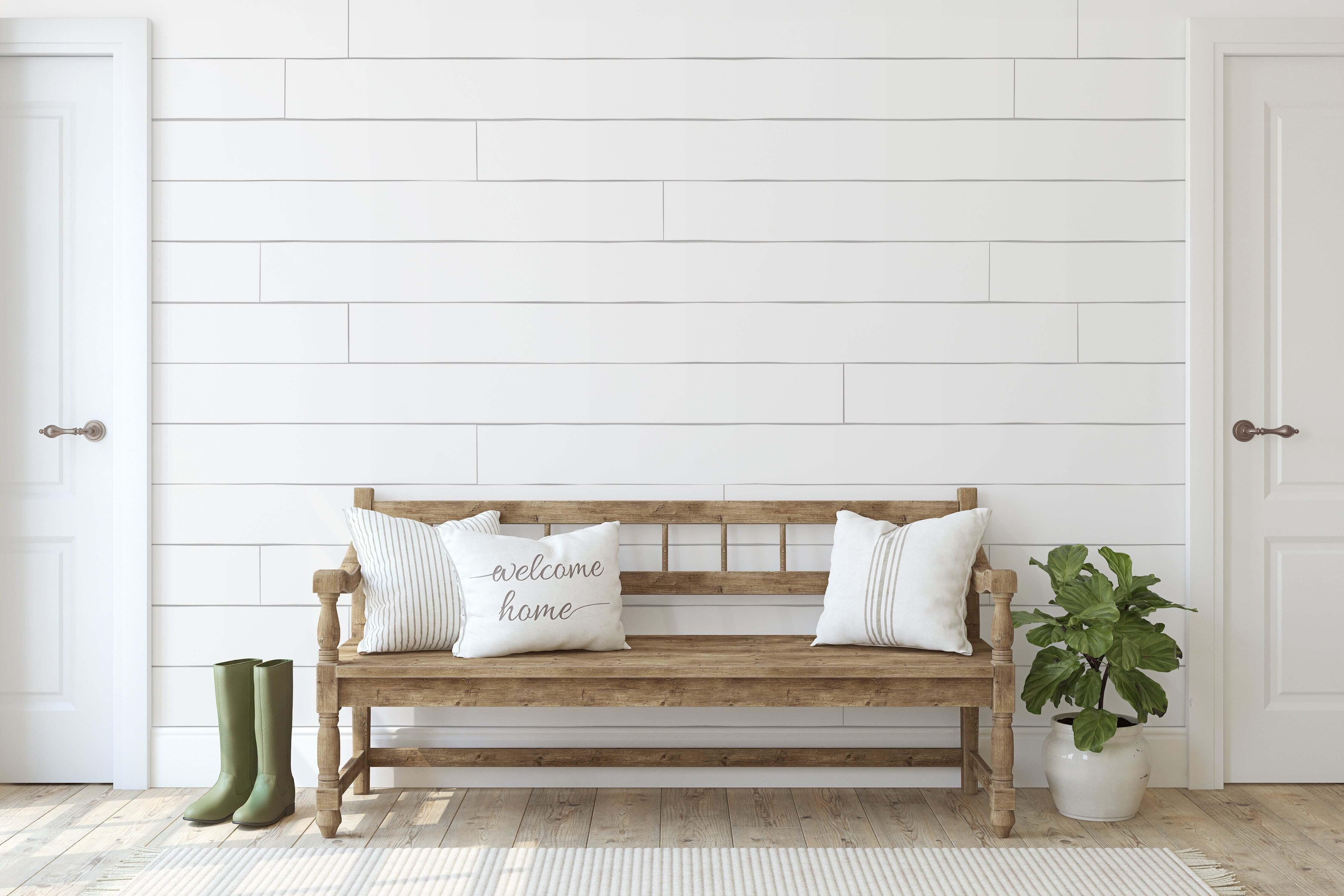 An entryway bench with pillows