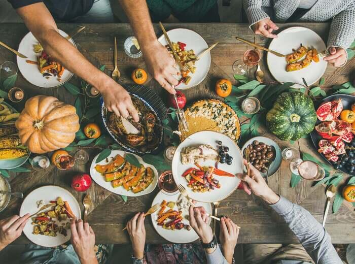 A large table full of Thanksgiving food