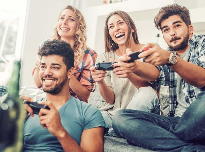 A group of friends playing video games