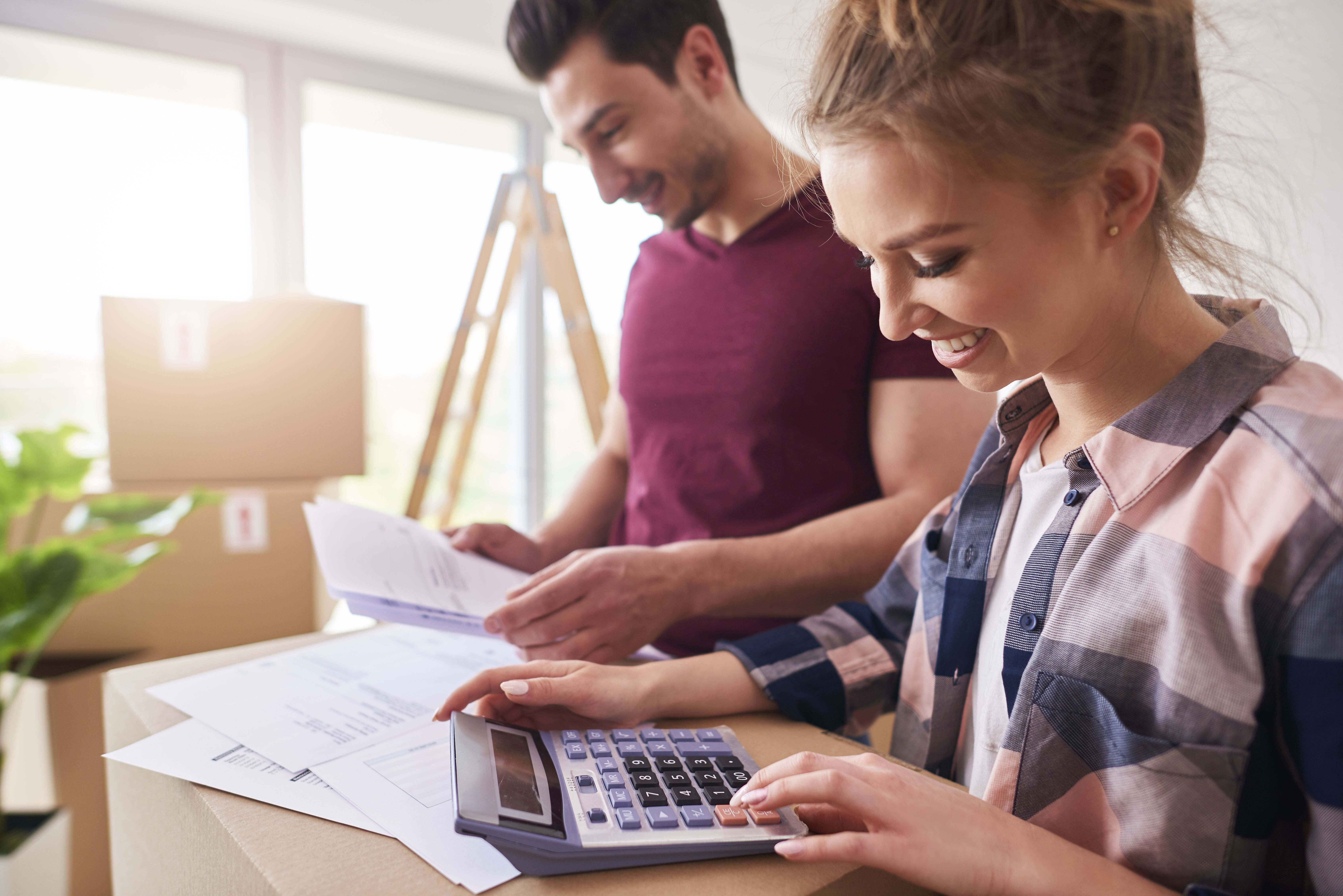 A couple going over their finances with a calculator