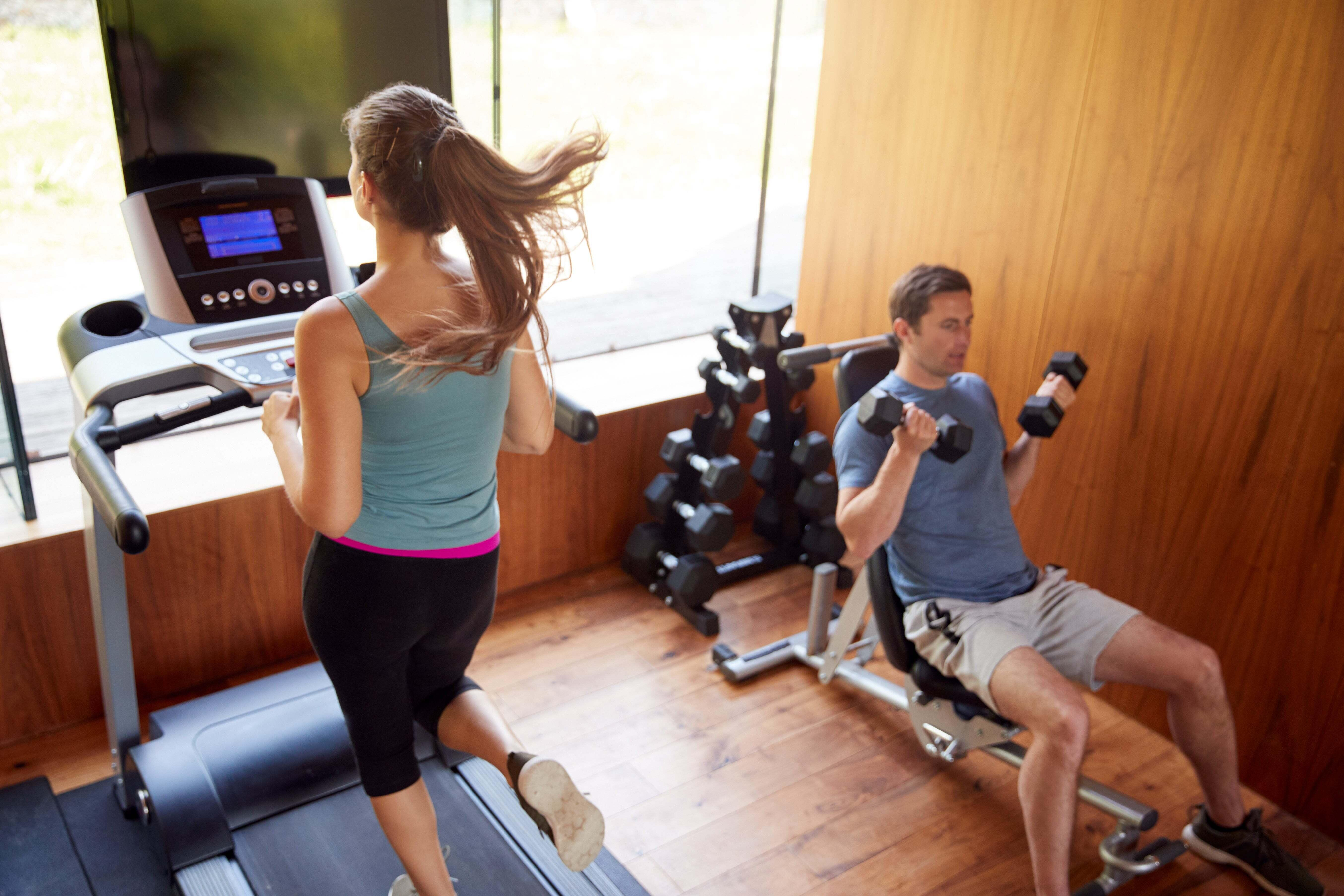 A man and woman working out in a gym