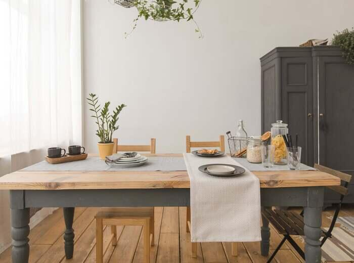A dining room table set with dishes
