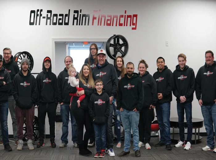 Off Road Rim Financing employees standing for a group photo